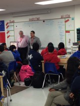 PEP graduates speaking to students at YES Prep