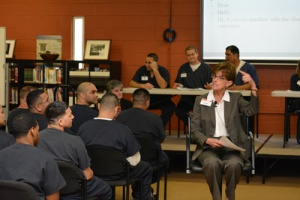 Colleen Rickenbacher teaching etiquette in prison